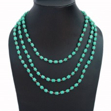 Triple strand blue glass bead necklace